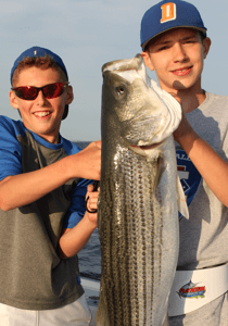 What could be better than taking young anglers like these two fishing for Block Island striped bass.