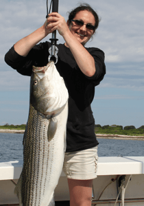 Enjoy a spectacular striped bass fishing trip with your wife.