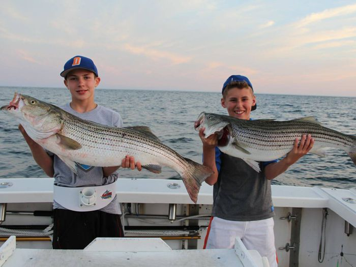 These two young anglers caught nice Block Island striped bass on Fish Trap.
